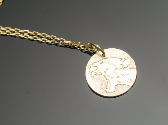 Hand engraved lioness pendant