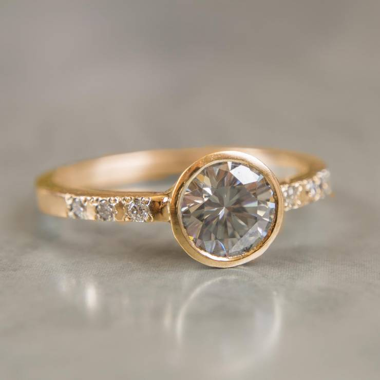 gray moissanite ring with diamond accents