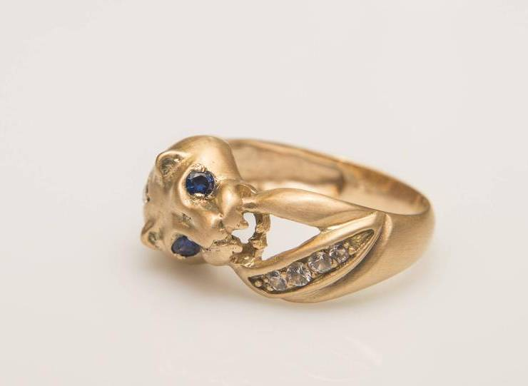 lioness ring with blue sapphires
